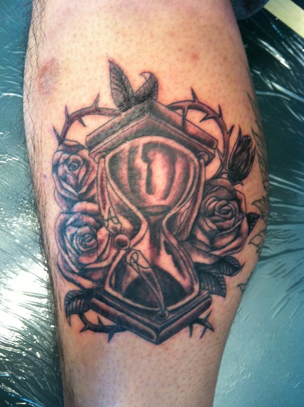 Black Ink Sandclock And Rose Tattoos On Arm