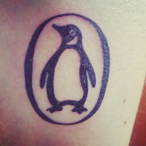 Black Penguin In Circle Tattoo
