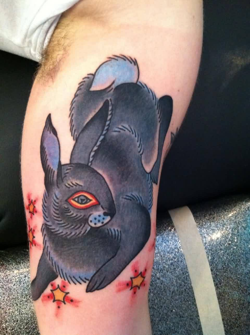 Black Rabbit And Tiny Star Tattoos On Arm