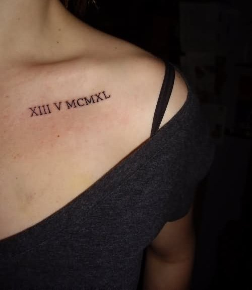 Black Roman Numerals Tattoos On Collarbone