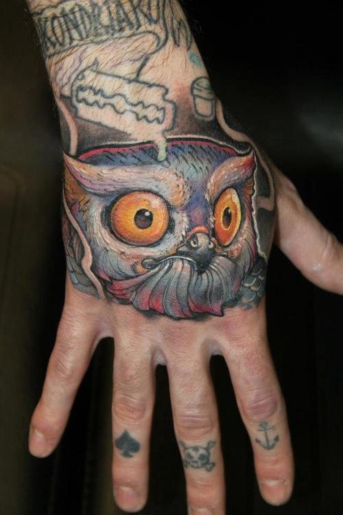 Blade And Owl Tattoos On Hand