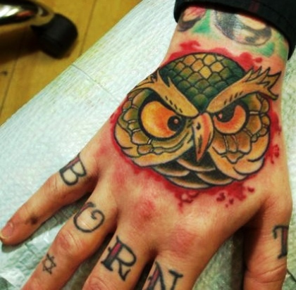 Blood And Owl Head Tattoo On Hand