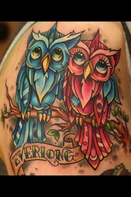 Blue And Red Owls Sitting On Branch Tattoo
