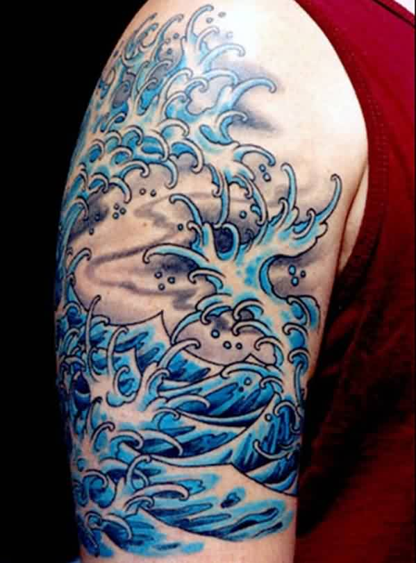 Blue Splashing Waves Tattoo On Half Sleeve