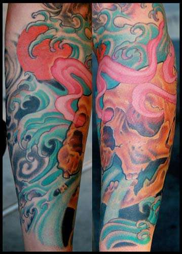 Blue Waves And Skull Tattoos On Sleeve
