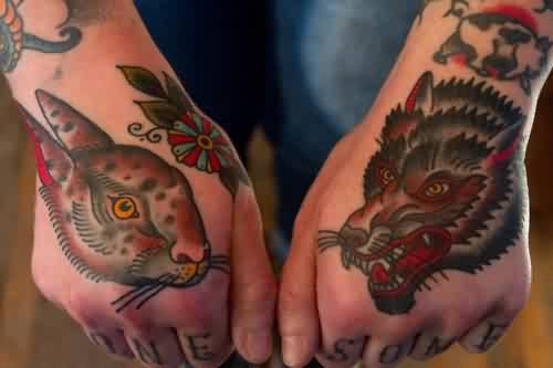 Bright Colored Rabbit And Wolf Head Tattoos On Hand
