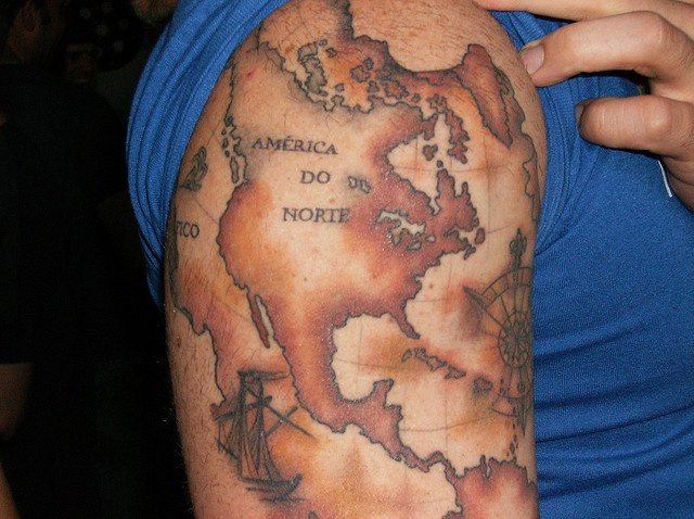 Brown Map And Compass Tattoos On Shoulder