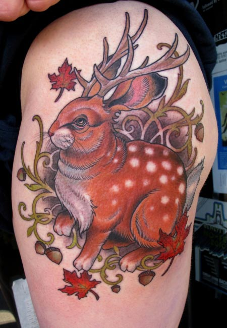 Brown Rabbit With Antlers Tattoo On Biceps