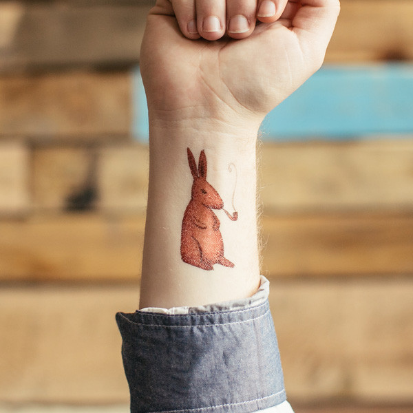 Brown Smoking Rabbit Tattoo On Inner Wrist
