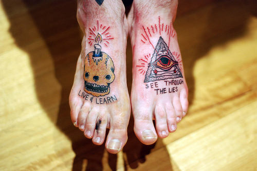 Candle Skull And Eye Triangle Tattoos On Feet