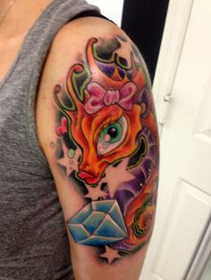 Cartoon Seahorse And Diamond Tattoos On Arm