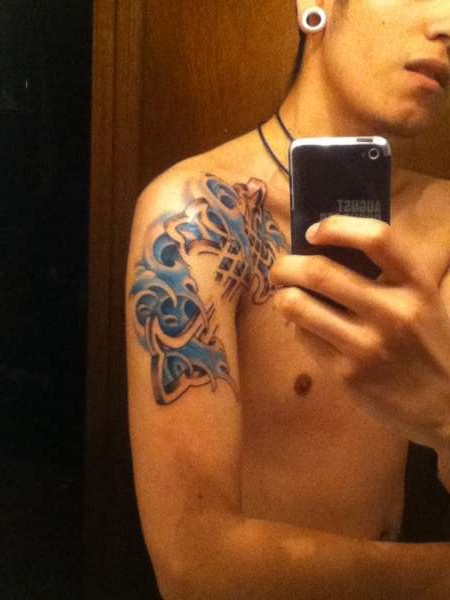 Celtic Cross With Blue Waves Tattoos On Shoulder For Boys