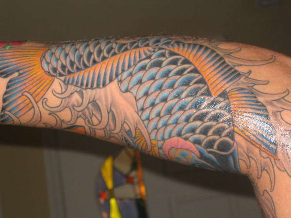 Charming Fish And Waves Tattoos For Men