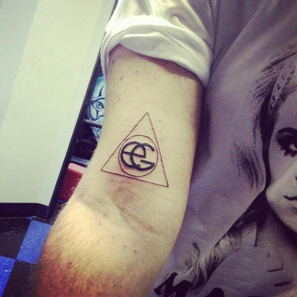 Circle In The Triangle Tattoo On Arm