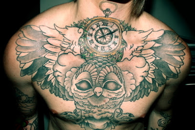 Clock And Owl Tattoos On Chest