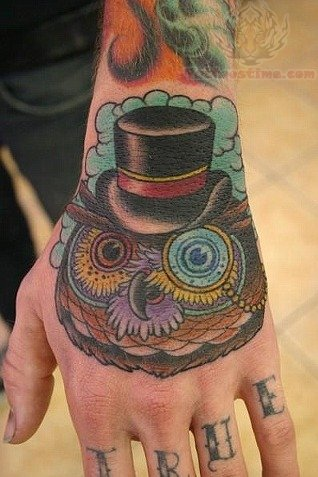 Clouds And Tophat Owl Tattoos On Hand