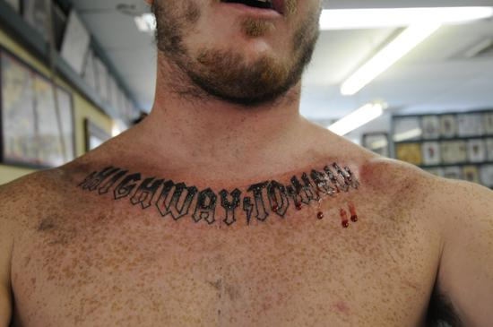 Collarbone Wording Tattoo For Men