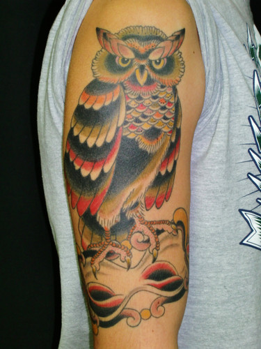 Color Owl On Sandclock Tattoo On Arm