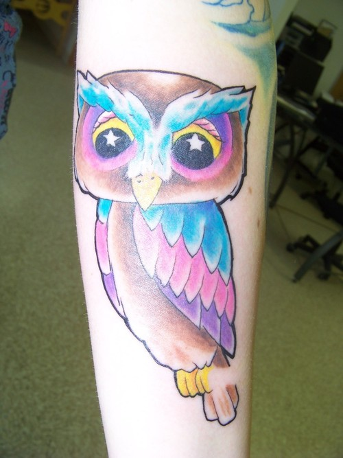 Color Owl With Stars Eyes Tattoo On Arm