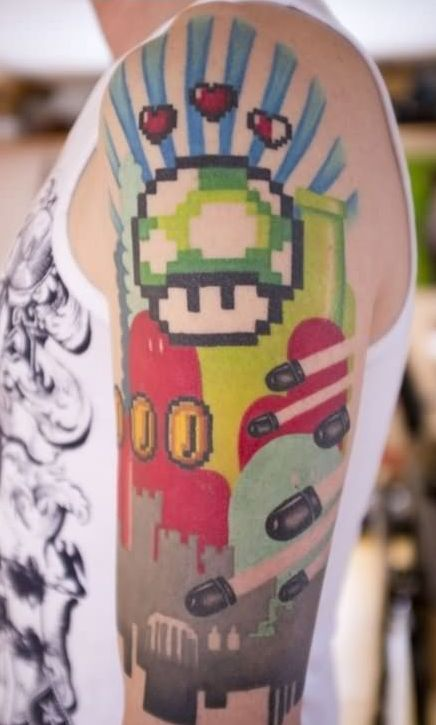 Colorful 3D Video Game Tattoos On Half Sleeve