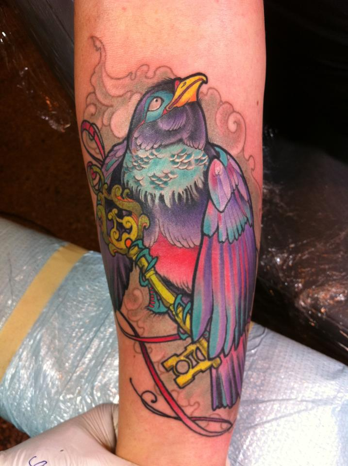 Colorful Crow With Key Tattoo On Arm