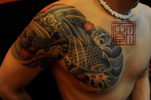 Cool Asian Fish And Wave Tattoos For Men