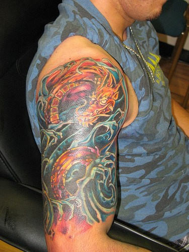 Cool Dragon And Wave Tattoos On Half Sleeve For Guys