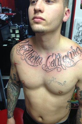 Cool Lettering Tattoos On Collarbones