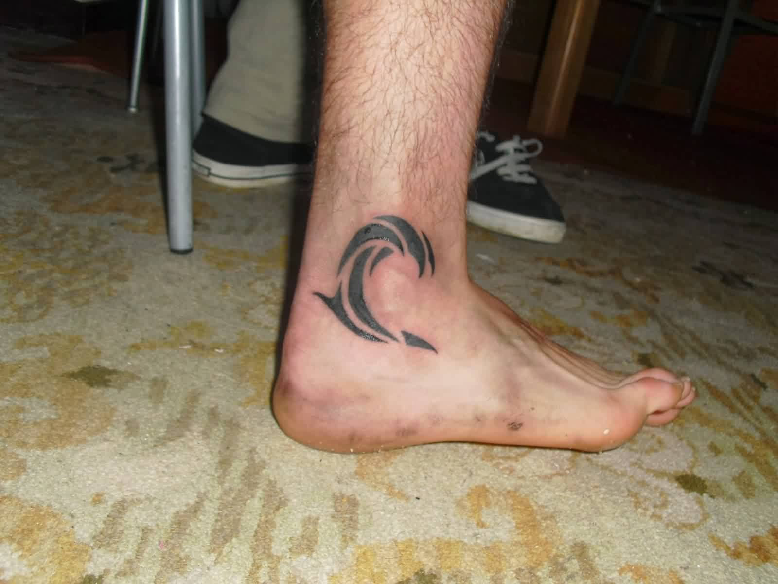 Cool Tribal Wave Tattoo On Ankle For Men