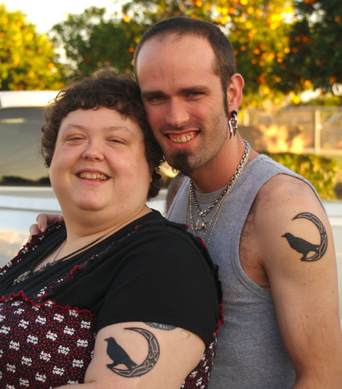Couple With Black Crow And Celtic Moon Tattoos