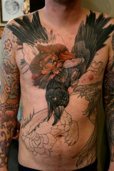 Crow In Animal Mouth Tattoo On Chest