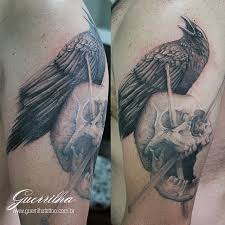 Crow On Skull Arm Tattoos