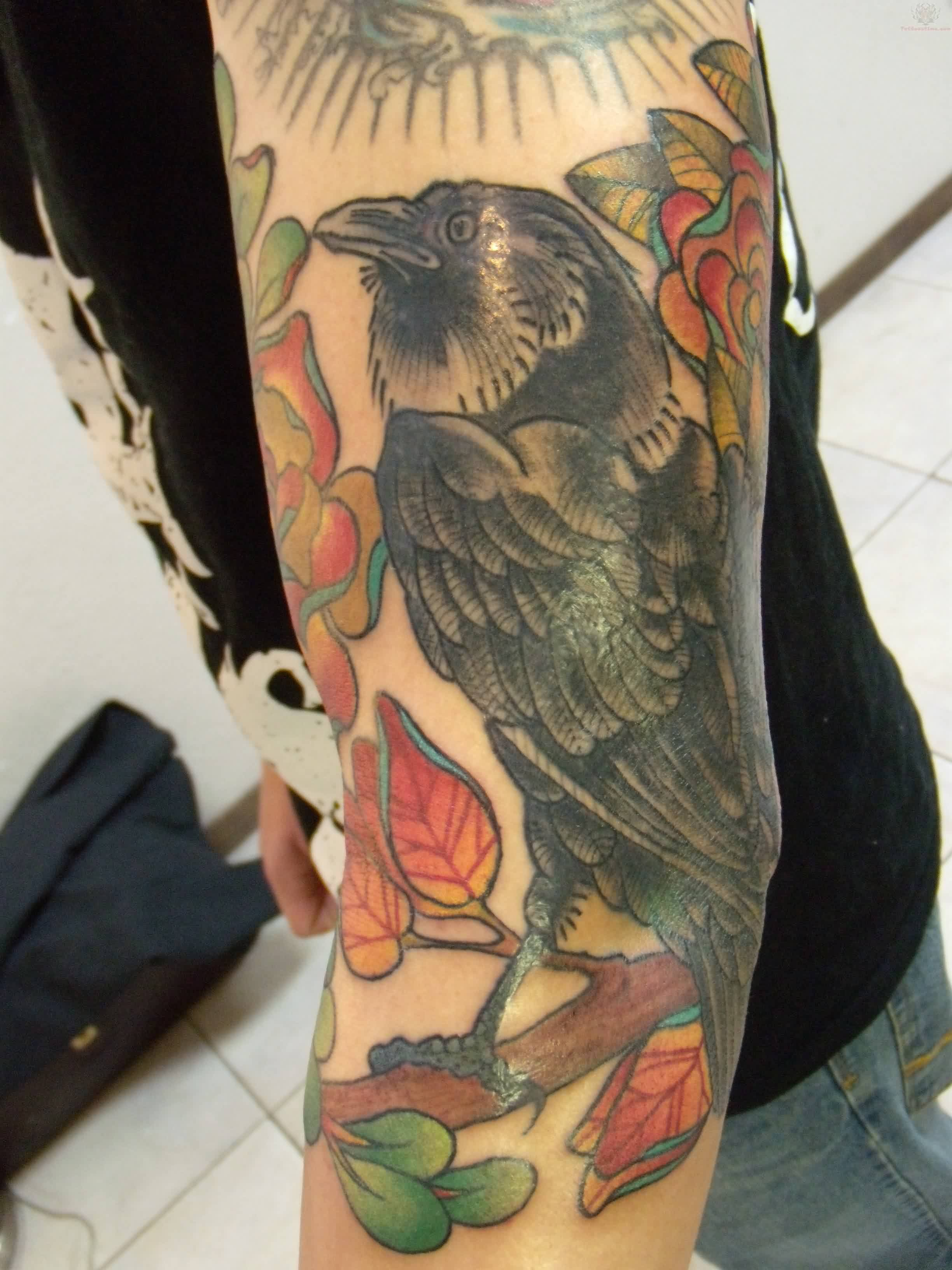 Crow Sitting On Branch Tattoo On Arm