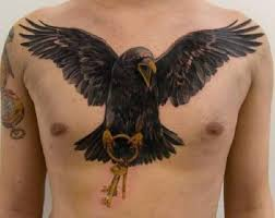 Crow With Golden Key Tattoo On Chest