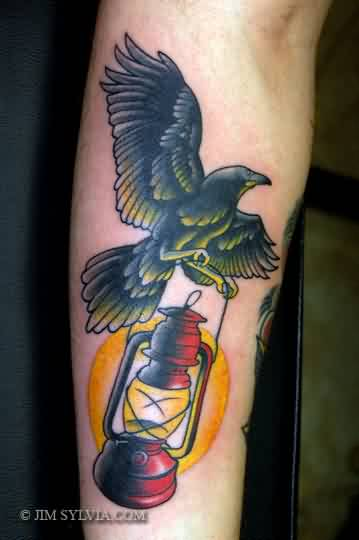 Crow With Night Lamp Tattoo On Arm