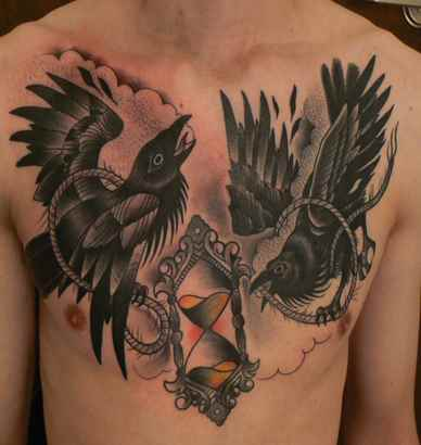 Crows And Sandclock Tattoos On Chest