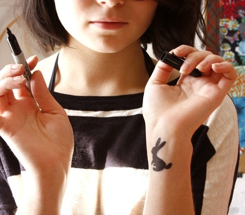 Cute Black Ink Rabbit Tattoo On Left Wrist