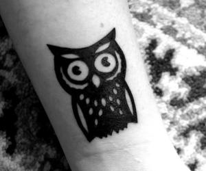 Cute Black Owl Tattoo On Wrist