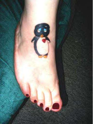Cute Blue Eyed Penguin Tattoo On Foot