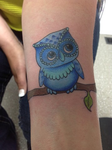 Cute Blue Owl On Branch Tattoo On Arm
