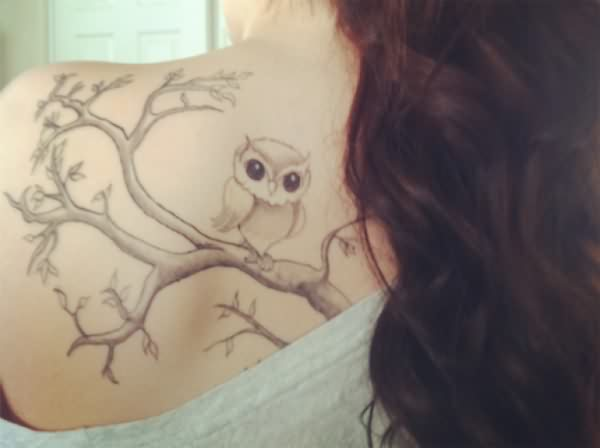 Cute Grey Owl Sitting On Tree Tattoo