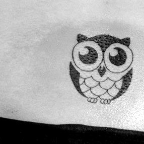 Cute Owl With Black Eyes Tattoo