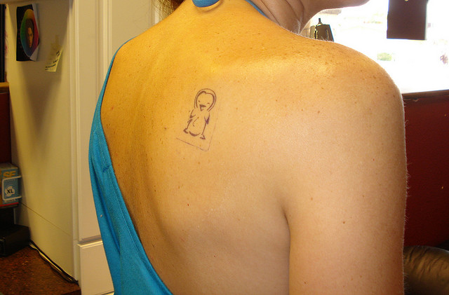 Cute Penguin Tattoo On Right Back Shoulder