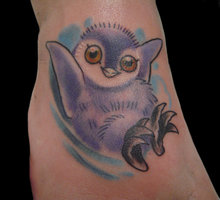 Cute Purple Penguin Tattoo On Foot