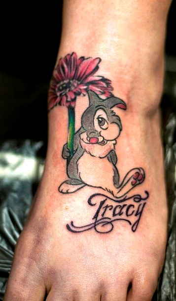 Cute Rabbit With Daisy Tattoo On Foot
