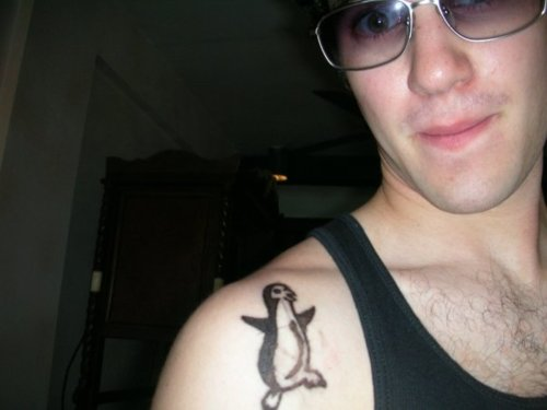 Dancing Penguin Tattoo On Right Front Shoulder