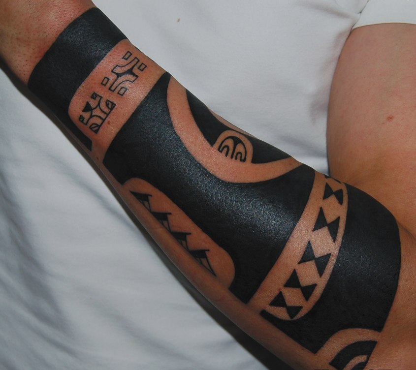 Dark Black Polynesian Tattoos On Arm