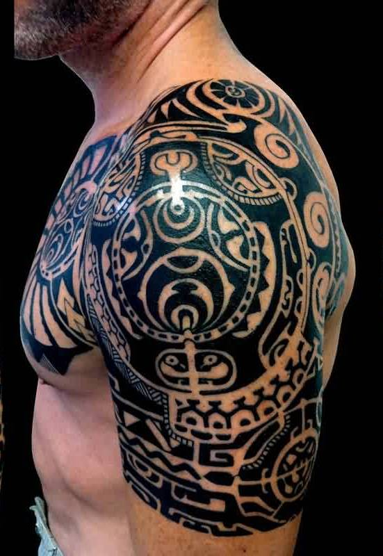 Dark Black Tribal Polynesian Tattoos On Chest And Half Sleeve