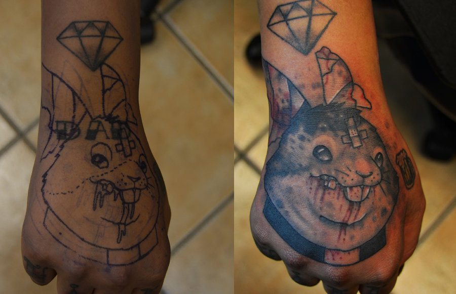 Diamond And Evil Rabbit Priest Tattoos On Hand