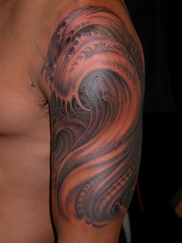 Fabulous Grey Biomechanical Wave Tattoo On Half Sleeve